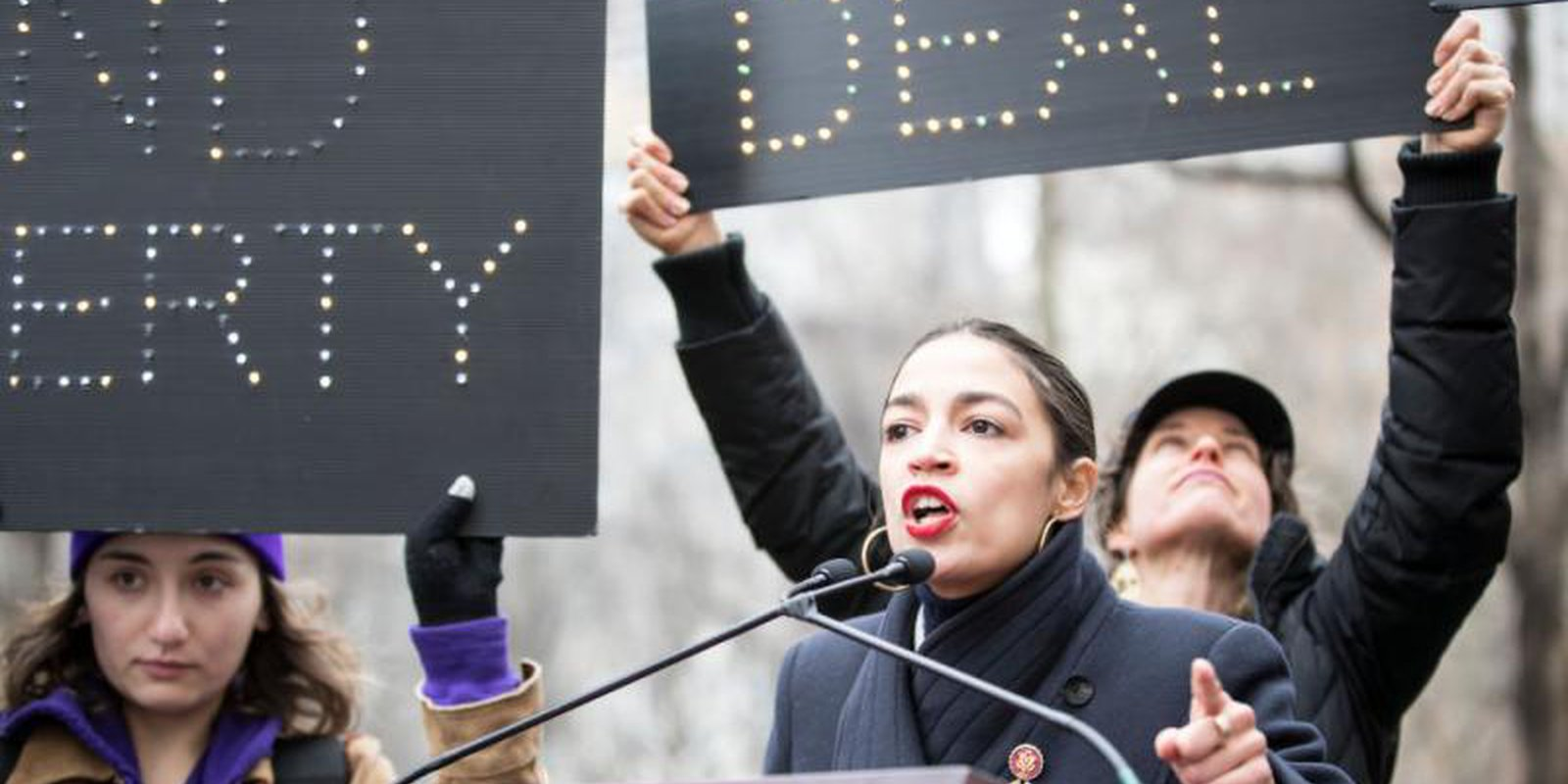 Alexandria Ocasio-Cortez addresses a crowd at the annual Women's March on 19 January 2019. Ocasio-Cortez is one of the newly-elected Democrats pushing for a Green New Deal. Photo: Getty Images.