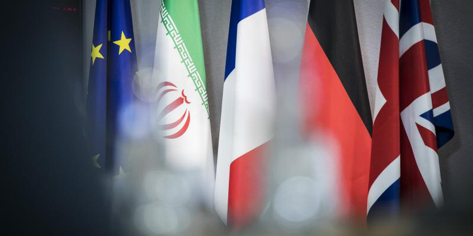 The flags of the EU, Iran, France, Germany and the UK are pictured before meetings on 15 May 2018 in Brussels, Belgium, in response to the US's announcement of its withdrawal from the Iran nuclear deal. Photo: Getty Images.