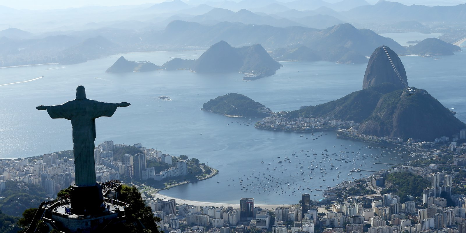RiodeJaneiro, Brazil- July 21: Aerial view of Christ the Redeemer, Flamengo Beach, the Sugar Loaf and Guanabara Bay with nearly one year to go to the Rio 2016 Olympic Games on July 21, 2015 in Rio de Janeiro, Brazil. (Photo by Matthew Stockman/Getty Images)