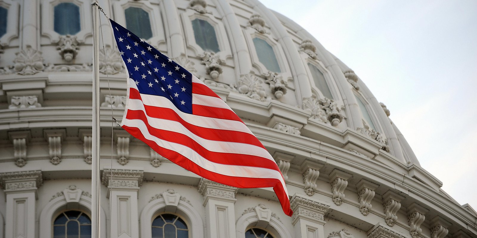 The US flag flies at the US Capitol in Washington, DC, January 20, 2009. Photo credit: STAN HONDA/AFP via Getty Images.