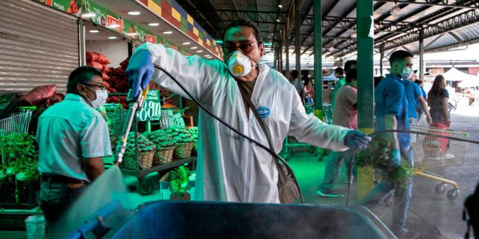 A municipal cleaning worker disinfects the central market in Santiago, Chile on 7 April 2020 amid the coronavirus pandemic. Photo: Getty Images.