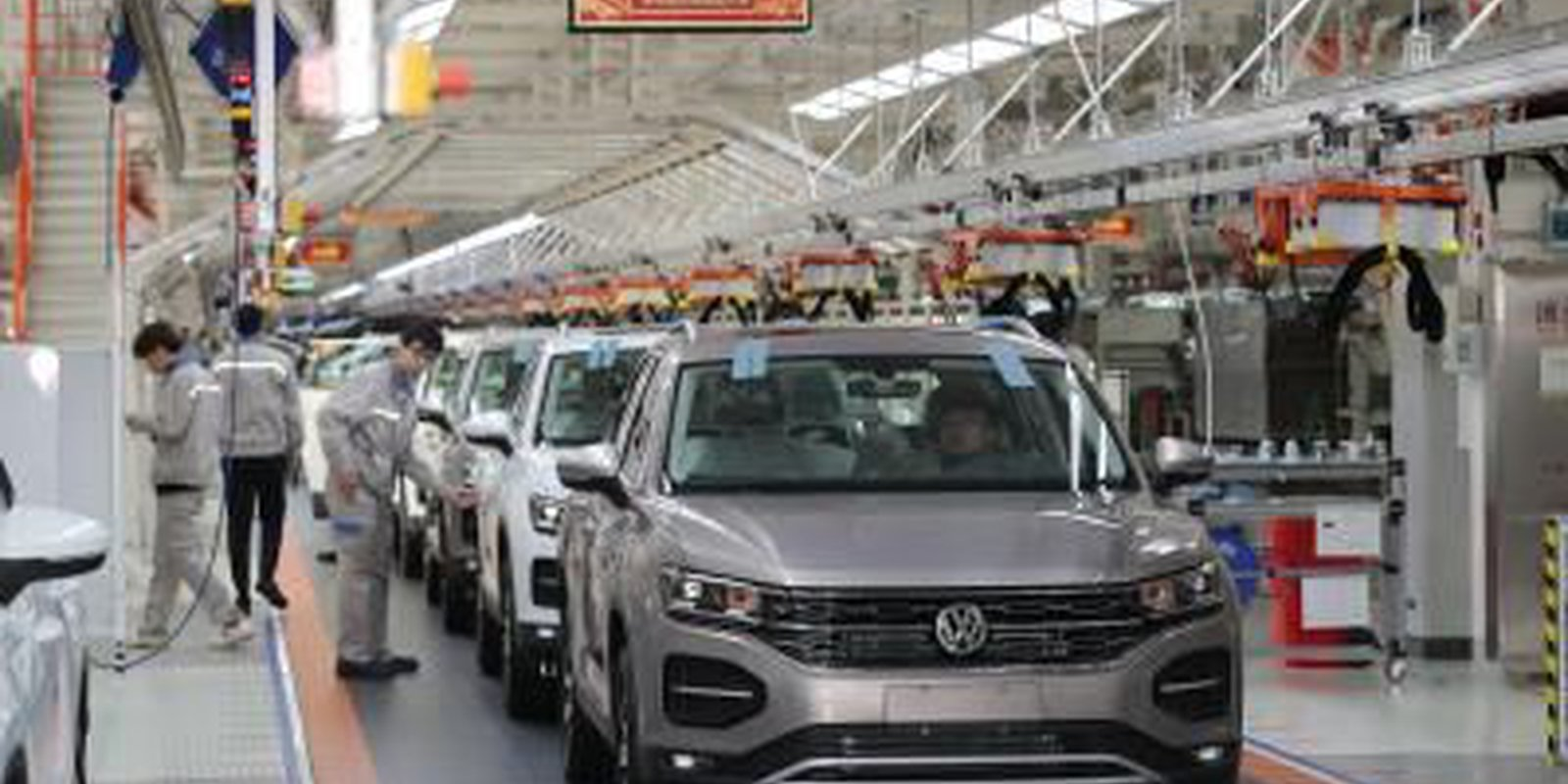 Image — Employees work on the assembly line of Volkswagen Tayron at a whole-vehicle manufacturing base of the Chinese-German joint venture FAW-Volkswagen Automotive Co Ltd on 5 December 2019 in Tianjin, China. Photo credit: Copyright © VCG/Contributor/Getty Image