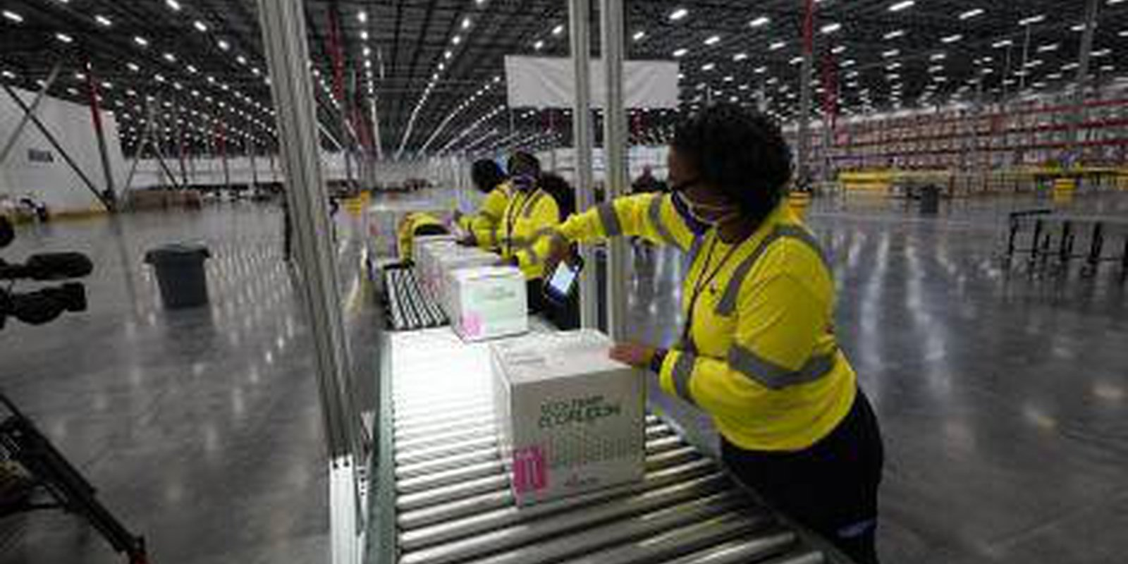 Image — Boxes containing the Moderna COVID-19 vaccine are prepared to be shipped at the McKesson distribution center on 20 December 2020 in Olive Branch, Mississippi, USA. Photo credit: Copyright © Paul Sancya/Pool/Getty Images