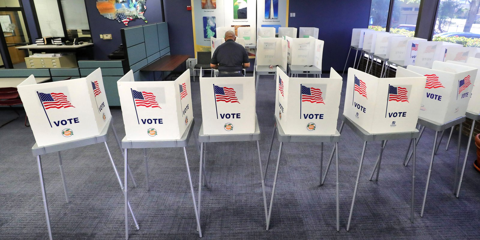 A voter casts his ballot at the Orange County Supervisor of Elections office in Orlando, Fla., Tuesday, March 17, 2020, in the Florida primary. Democratic voters are making their choice for their party's nominee in the 2020 presidential election. (Joe Burbank/Orlando Sentinel/Tribune News Service via Getty Images)