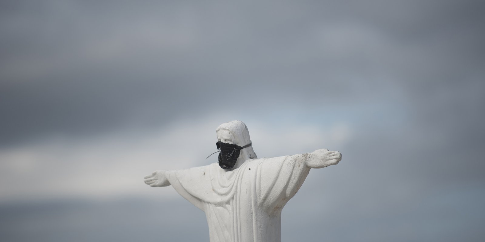 Replica of Christ the Redeemer with surgical mask on Copacabana beach, to remind people about the danger of the coronavirus (COVID-19) in Rio De Janeiro, Brazil on April 01, 2020. (Photo by Fabio Teixeira/Anadolu Agency via Getty Images)