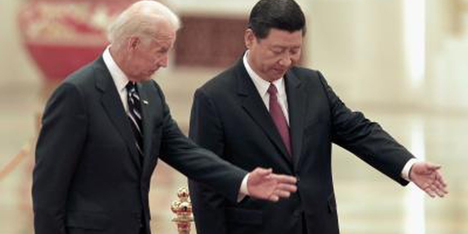 Image — Xi Jinping meets Joe Biden at a welcoming ceremony inside the Great Hall of the People in Beijing, China. Photo by Lintao Zhang/Getty Images.