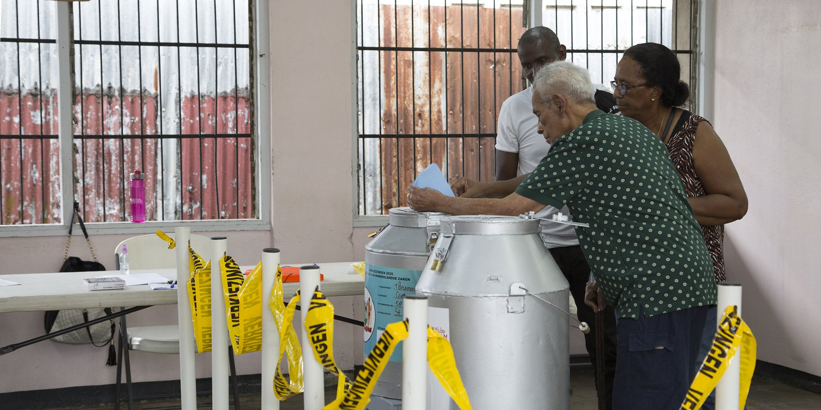 A man cast his vote at a polling station in Paramaribo on May 25, 2020 during parliamentary elections. Photo by DANNY LIU/AFP via Getty Images.
