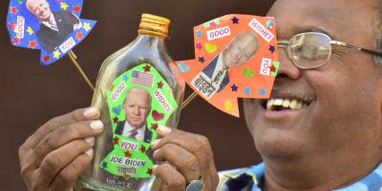Image — Entrepreneur Jagmohan Kanojia displays his miniature kites supporting Joe Biden's election as US president in Amritsar, India. Photo by Sameer Sehgal/Hindustan Times via Getty Images.