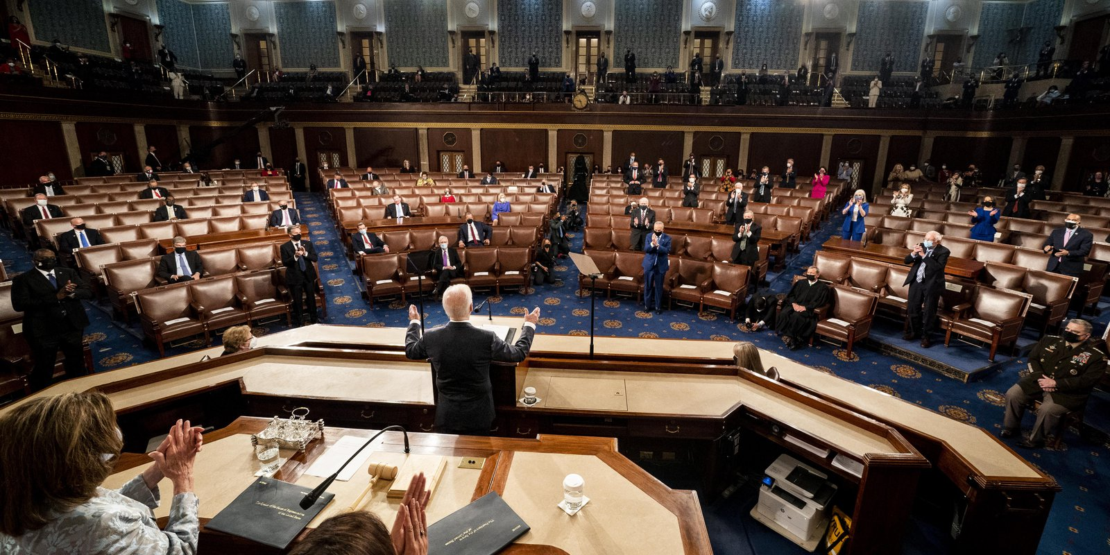 Image — President Joe Biden addresses a Joint Session of Congress, with Speaker of the House Nancy Pelosi and Vice President Kamala Harris behind on the dais. Photo by Melina Mara - Pool/Getty Images.