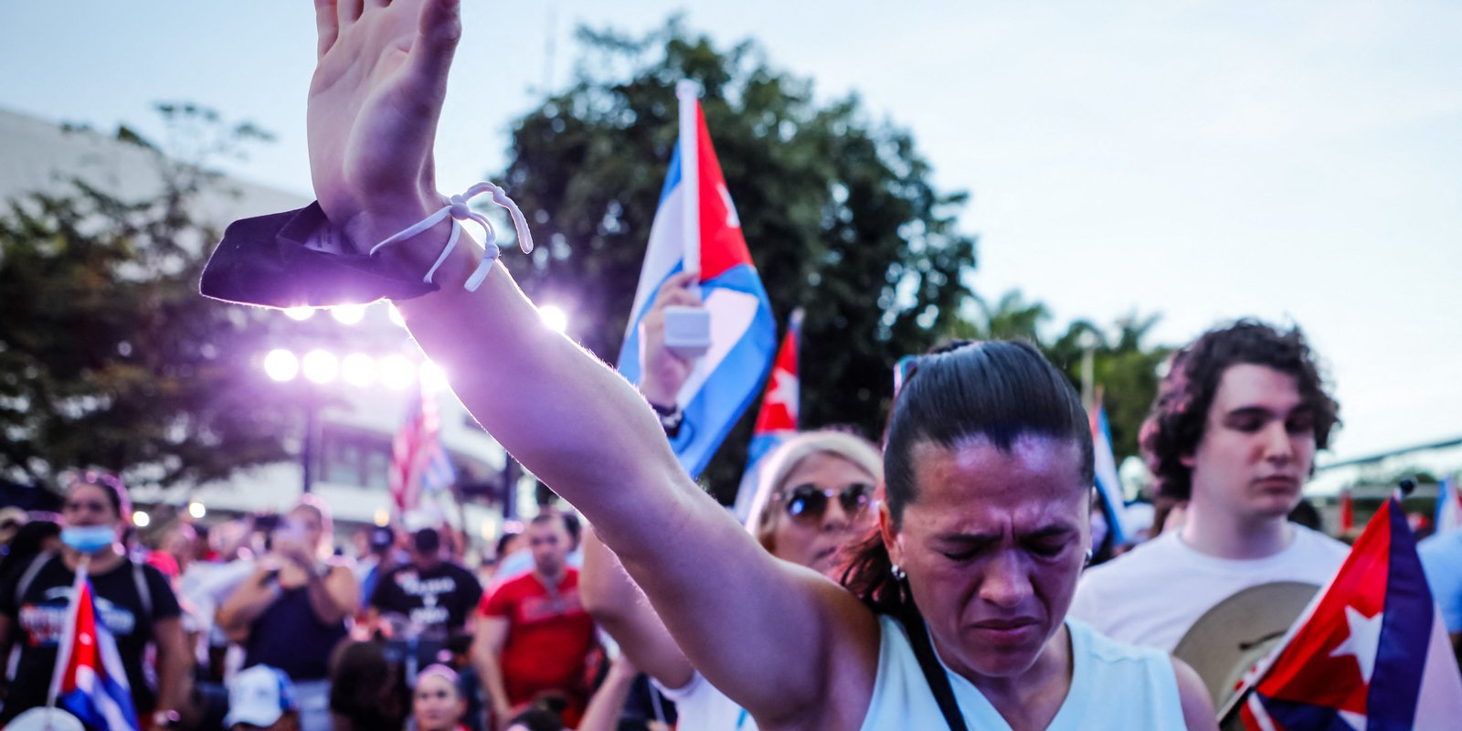 Image — A woman prays during a rally in support of Cubans demonstrating against their governmentat Freedom Tower in Miami, USA. Photo by EVA MARIE UZCATEGUI/AFP via Getty Images.