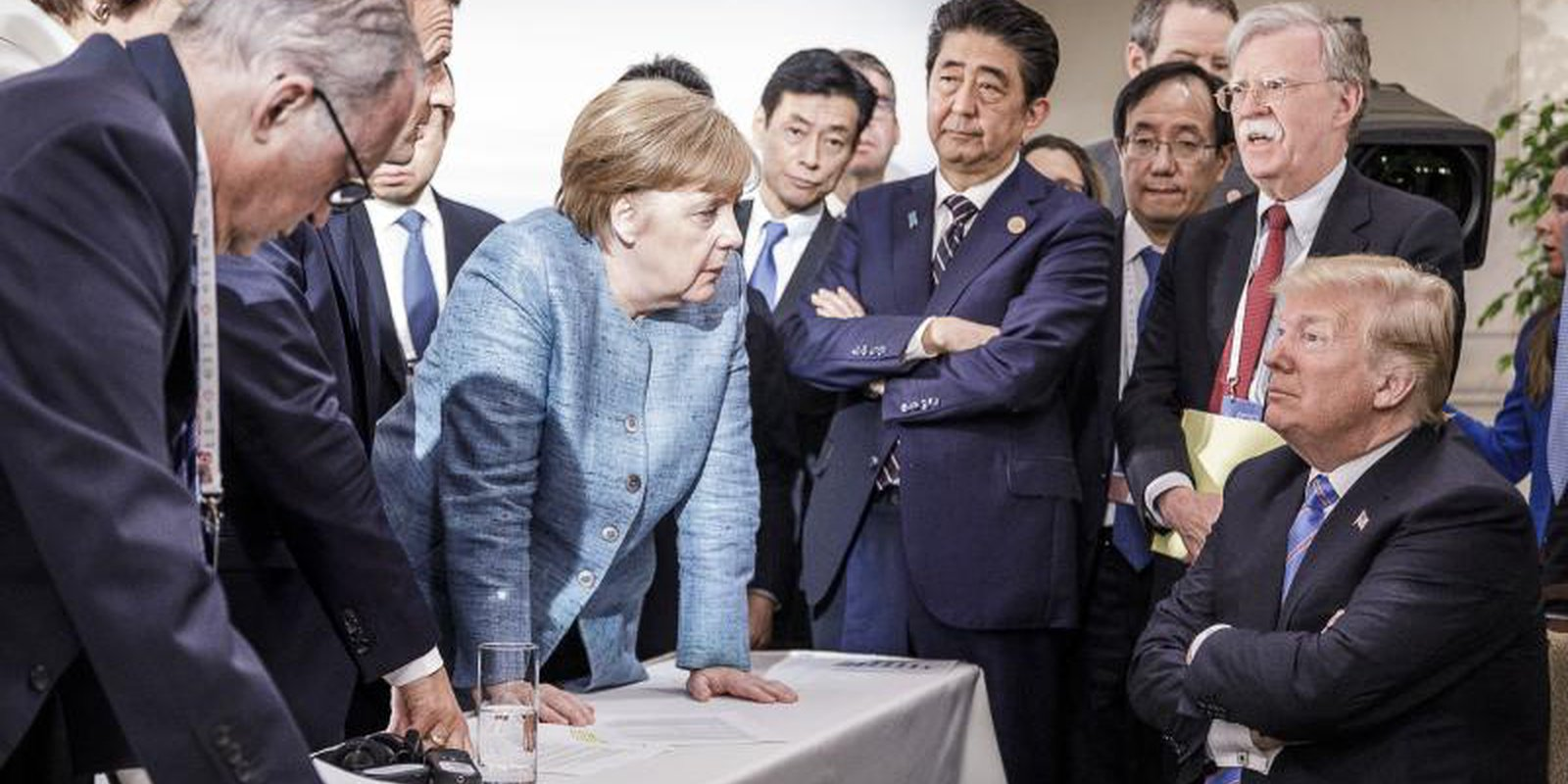 Angela Merkel and other world leaders deliberate with US president Donald Trump at the G7 summit in 2018. Photo by Jesco Denzel /Bundesregierung via Getty Images.