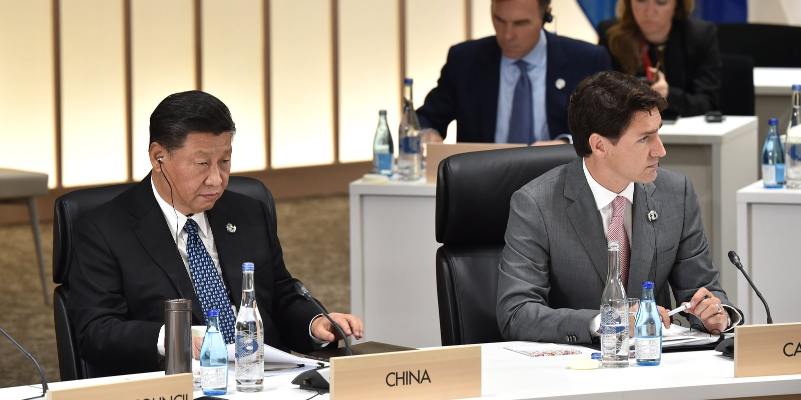 China's President Xi Jinping and Canada's Prime Minister Justin Trudeau attend a session on women's workforce participation, future of work and aging societies at the G20 Summit on 29 June 2019 in Osaka, Japan. Photo: Getty Images.