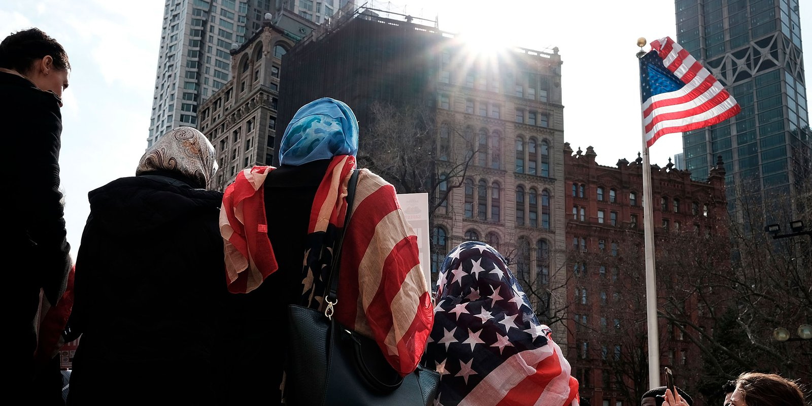 New York, NY - 01 February 2017: Women wear an American Flag head scarf at an event at City Hall for World Hijab Day. Photo by Spencer Platt/Getty Images.