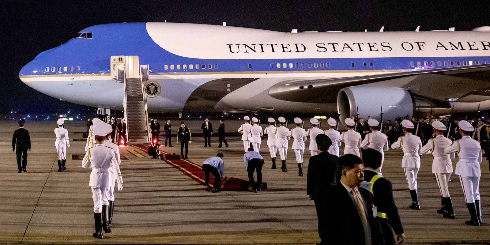 Workers roll out a red carpet in front of Air Force One carrying US President Donald Trump at Noi Bai International Airport in Hanoi, Vietnam, on 26 February 2019. Photographer: Justin Chin/Bloomberg via Getty Images